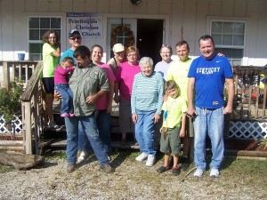 Pastor John, Kim & Emily, Rob, Luke & Dakota with most of the members that came to rebuild John & Kim's home!