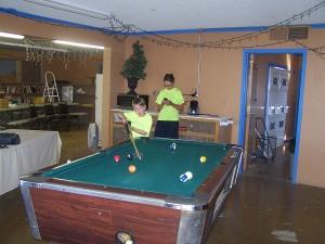 Luke playing pool in the rec area!