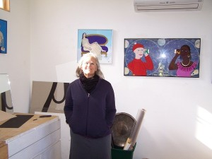 Janet Miller in her studio - reverse glass painting is her specialty, but not her only talent